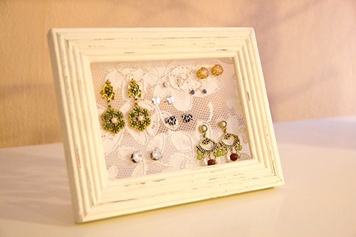 Framed lace used as your earring holder