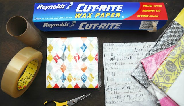 Stick double-sided tape to wax paper