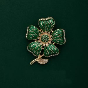 green floral brooches