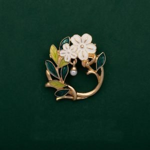 white flower brooches